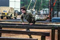 Spc. Kara Agnew hurdles over a beam as she tackles the air assault school obstacle course at Fort Bragg, N.C., on Jan. 4. (US Army photo/Daniel Schroeder)
