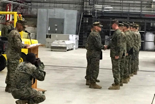 Marines receive medals from the Commandant of the Marine Corps at Naval Air Station Sigonella, Italy for supporting an investigation into the deaths of Green Berets in Niger. (Hope Hodge Seck/Military.com)