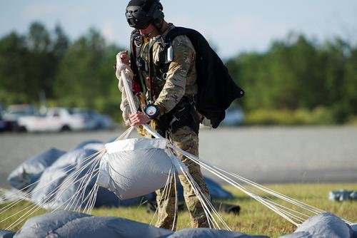 U.S. Air Force Master Sgt. William Posch, a pararescueman from the 308st Rescue Squadron, Patrick Air Force Base, Florida, daisy chains his lines from a parachute he used during drop zone familiarization training at Guardian Centers, Perry, Georgia, October 11, 2017. Posch was among seven airmen killed March 15 in a helicopter crash in western Iraq. (Stephen Schester/Air Force)