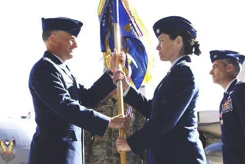 Lt. Col. Brenda Cartier is presented with the guidon to her new squadron during a change-of-command ceremony at Hurlburt Field, Florida, on Feb. 20, 2009. At the time, she became the first female commander of a flying squadron. (US Air Force photo)