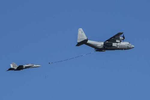 An F/A-18D Hornet with Marine All-Weather Fighter Attack Squadron (VMFA) 242, and a KC-130J Hercules with Marine Aerial Refueler Transport Squadron (VMGR) 152, conduct simulated aerial refueling during the 41st Japan Maritime Self-Defense Force – Marine Corps Air Station Iwakuni Friendship Day at MCAS Iwakuni, Japan, May 5, 2017. (U.S. Marine Corps photo/Aaron Henson)
