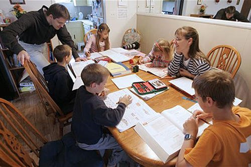 In this March 13, 2009, file photo, Uwe Romeike, top left, and his wife Hannelore, second from right, teach their children at their home in Morristown, Tenn. The family fled Germany in order to home-school their children.